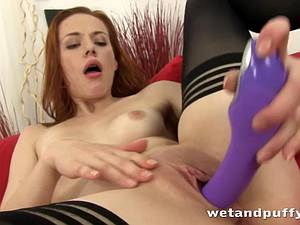 Ginger with a shaved pussy down for solo loving
